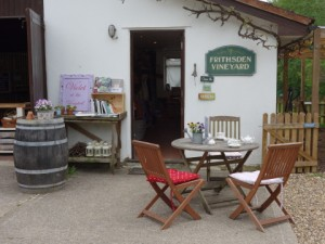 Table and chairs outside the shop at Frithsden